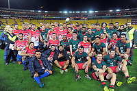 The teams pose for a group photo after the Heartland Championship preseason rugby match between Horowhenua Kapiti and Wairarapa Bush at Westpac Stadium in Wellington, New Zealand on Saturday, 5 May 2018. Photo: Dave Lintott / lintottphoto.co.nz