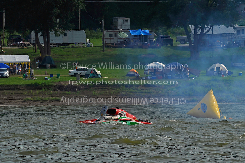"""Frame 18: On the 4th lap of the final heat David Villwock, U-96 """"Spirit of Qatar"""" spins into the path of Steve David, U-1 """"Oh Boy! Oberto"""", David t-bones Villwock and then launchs off the the Qatar hull into the air rolling over once and coming to stop upright. Both drivers were unhurt."""