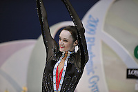 "September 11, 2009; Mie, Japan;  Anna Bessonova of Ukraine waves to fans from ""kiss & cry"" during individual All Around final at the 2009 World Championships Mie, Japan. Anna (the 2007 Patras world champion) placed 3rd in the AA final on this day at Mie.  Photo by Tom Theobald."