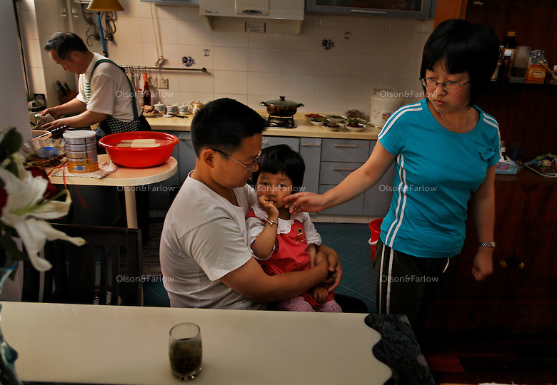 Wang Wei Gang and his family.  Wang Wei Gang is Production Mgr for pharmaceutical plant. Mother is Kitty Ding, Grandfather is Yi Ming Ding, Grandmother is Rong Qin Jiang. The mothers sister is Swallow Ding. kitty.ding@nei-group.com..The reason this family is interesting is because the grandparents were farmers and lost the land and their occupations to development.  The same kind of development that now supports their daughter Ding who works in the same industrial park as her husband.