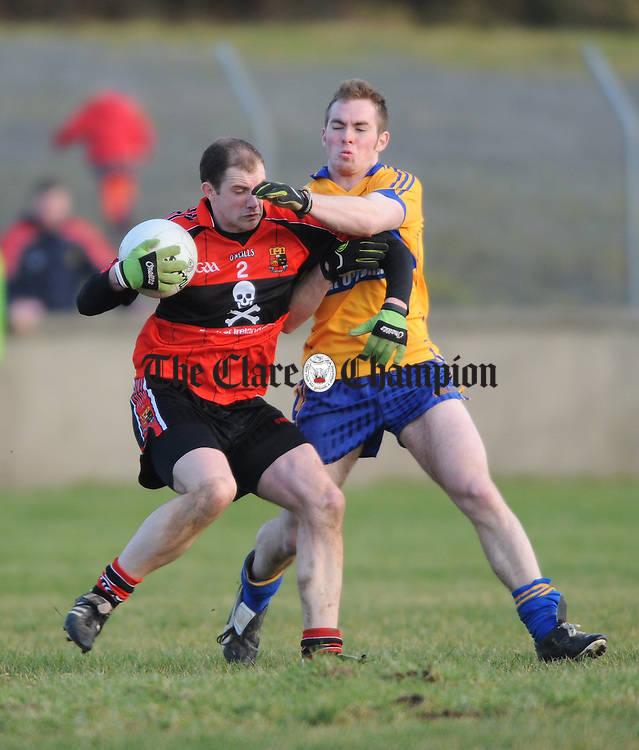 Donal Og O Donovan of UCC is tackled by Clare's Podge Mc Mahon during their Mc Grath Cup Game at Cooraclare. Photograph by John Kelly.