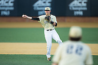 Wake Forest Demon Deacons shortstop Drew Freedman (5) makes a throw to first base against the UConn Huskies at Wake Forest Baseball Park on March 17, 2015 in Winston-Salem, North Carolina.  The Demon Deacons defeated the Huskies 6-2.  (Brian Westerholt/Four Seam Images)