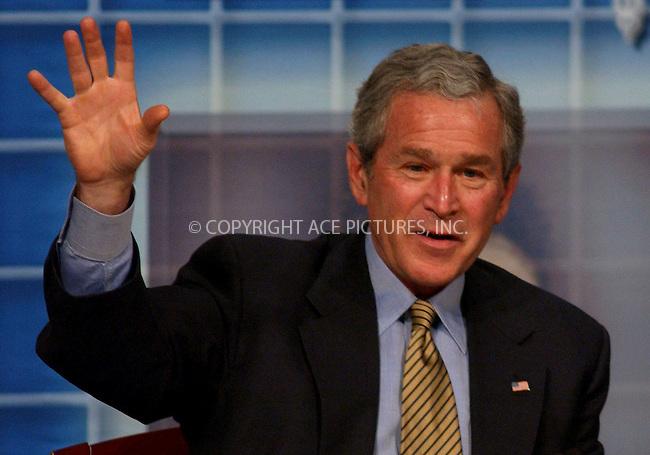 WWW.ACEPIXS.COM . . . . . ....BRIDGEPORT, CONNECTICUT, APRIL 5, 2006....US President George W. Bush listens to a panelist during a town hall style meeting on Health Savings Accounts .....Please byline: KRISTIN CALLAHAN - ACEPIXS.COM.. . . . . . ..Ace Pictures, Inc:  ..(212) 243-8787 or (646) 679 0430..e-mail: info@acepixs.com..web: http://www.acepixs.com