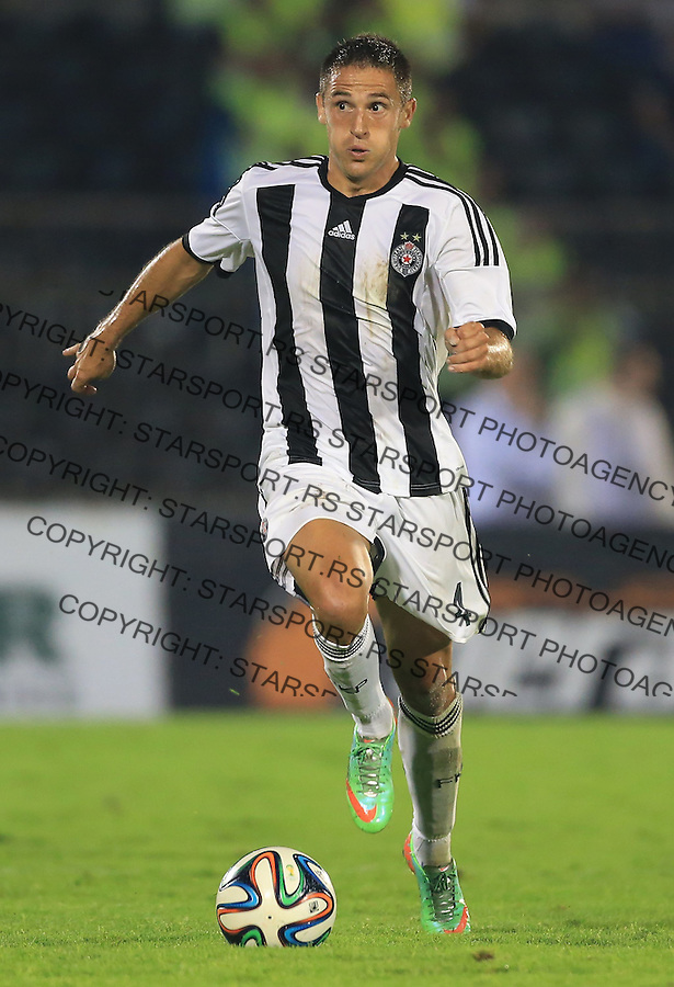 BELGRADE, SERBIA - AUGUST 06: Miroslav Vulicevic of FC Partizan Belgrade in action during the UEFA Champions League third qualifying round 2nd leg match between Partizan Belgrade and Ludogorets Razgrad at the Stadium JNA on August 06, 2014 in Belgrade, Serbia, 2014. (Photo by Srdjan Stevanovic/Getty Images)
