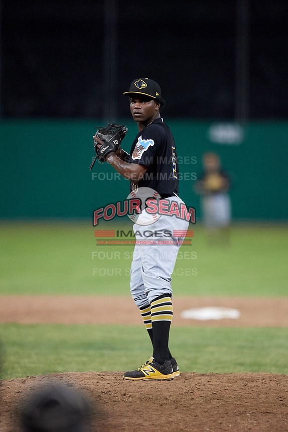 West Virginia Black Bears relief pitcher Juan Henriquez (58) gets ready to deliver a pitch during a game against the Batavia Muckdogs on July 2, 2018 at Dwyer Stadium in Batavia, New York.  West Virginia defeated Batavia 3-1.  (Mike Janes/Four Seam Images)