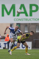 Mark McChrystal of Bristol Rovers beats Matty Cash Dagenham & Redbridge in the air during the Sky Bet League 2 match between Bristol Rovers and Dagenham and Redbridge at the Memorial Stadium, Bristol, England on 7 May 2016. Photo by Mark  Hawkins / PRiME Media Images.