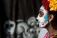 A young woman, dressed as La Catrina, a Mexican pop culture icon representing the Death, walks through the town during the Day of the Dead festivities in Mexico City, Mexico, 28 October 2016. Day of the Dead (Día de Muertos), a syncretic religious holiday combining the death veneration rituals of the ancient Aztec culture with the Catholic practice, is celebrated throughout all Mexico. Based on the belief that the souls of the departed may come back to this world on that day, people gather at the gravesites in cemeteries praying, drinking and playing music, to joyfully remember friends or family members who have died and to support their souls on the spiritual journey.