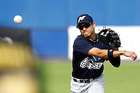 10 September 2011: Zerzinho Croes of Vaessen Pioniers throws the ball  to first base during game 4 of the 2011 Holland Series won 6-2 by L&D Amsterdam Pirates over Vaessen Pioniers, in Amsterdam, Netherlands.