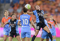 Vanessa DiBernardo (10) of the Chicago Red Stars heads the ball away from her goal in the first half against the Houston Dash on Saturday, April 16, 2016 at BBVA Compass Stadium in Houston Texas.