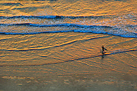 Surfer at sunsetKuta Beach, Legian Bali,aerial view,