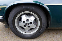 "Pictured: One of the alloy wheels of the Jaguar up for auction, once owned by Eamonn Holmes<br /> Re: A luxury open-top car sold by TV's Eamonn Holmes to pay off his ""massive"" tax bill is up for grabs at auction.<br /> The host of Good Morning Britain bought the 5.3 litre Jaguar when he was earning big bucks with the BBC.<br /> But Eamonn was made redundant and at the same time he was hit with an £11,000 demand from the Inland Revenue.<br /> The car was costing him a fortune to run - it did under 15mpg.<br /> After paying a whopping £36,000 for the Jaguar XJSC, Eamonn flogged it for just £8,000 a year later.<br /> The car has an identical price tag at auction almost 30 years later.    <br /> Eamonn, 57, told how he got shot of the Jag when the 1990 Gulf War sparked a big hike in fuel prices.<br /> He said: ""Cars are my weakness - in 1989 I bought a British Racing Green Jaguar.<br /> ""I paid £36,000 in March 1989 then in early 1990 the Gulf War broke out."