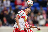 Tim Cahill (17) of the New York Red Bulls heads the ball. The New York Red Bulls and Chivas USA played to a 1-1 tie during a Major League Soccer (MLS) match at Red Bull Arena in Harrison, NJ, on March 30, 2014.