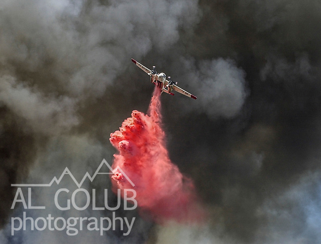 August 18, 2001 Coulterville, California  -- Creek Fire – Air tanker drops retardant on active fire line near Alan Haig Ranch.  The Creek Fire burned 11,500 acres between Highway 49 and Priest-Coulterville Road a few miles north of Coulterville, California.