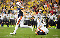 Jan 10, 2011; Glendale, AZ, USA; Auburn Tigers kicker Wes Byrum (18) celebrates with quarterback Neil Caudle (left) after kicking the game-winning field goal as time expires to defeat the Oregon Ducks 22-19 in the 2011 BCS National Championship game at University of Phoenix Stadium.  Mandatory Credit: Mark J. Rebilas-