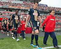 Philadelphia Union midfielder Sebastien Le Toux #9 walks onto the pitch during the opening ceremonies of an MLS game between the Philadelphia Union and the Toronto FC at BMO Field in Toronto on May 28, 2011..The Philadelphia Union won 6-2..