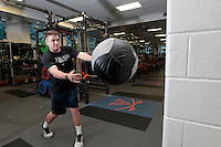 Assistant UVa strength and conditioning coach  Steven Cuccia demonstrates the med ball throws exercise at the McCue Center weight room on campus at the University of Virginia in Charlottesville, VA. Photo/Andrew Shurtleff