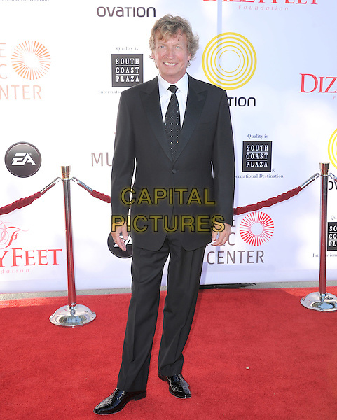 Nigel Lythgoe.attends the Dizzy Feet Foundation's Celebration of Dance Gala held at The Dorothy Chandler Pavilion at The Music Center in Los Angeles, California, USA,  July 28th 2012..full length  black tie suit                                       .CAP/RKE/DVS.©DVS/RockinExposures/Capital Pictures.
