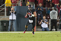STANFORD, CA - OCTOBER 5, 2013:  A.J. Tarpley runs back his interception during Stanford's game against University of Washington. The Cardinal defeated the Huskies 31-28.