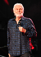 """20 March 2020 - Kenny Rogers, whose legendary music career spanned nearly six decades, has died at the age of 81. Rogers was inducted to the Country Music Hall of Fame in 2013."""" He had 24 No. 1 hits and through his career more than 50 million albums sold in the US alone. He was a six-time Country Music Awards winner and three-time Grammy Award winner. Some of his hits included """"Lady,"""" """"Lucille,"""" """"We've Got Tonight,"""" """"Islands In The Stream,"""" and """"Through the Years."""" His 1978 song """"The Gambler"""" inspired multiple TV movies, with Rogers as the main character. File Photo: 08 June 2017 - Nashville, Tennessee - Kenny Rogers. 2017 CMA Music Festival Nightly Concert held at Nissan Stadium. Photo Credit: Laura Farr/AdMedia"""