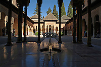 Tourists in the Patio de los Leones area at Alhambra, a 14th-century palace in Granada, Andalusia, Spain.