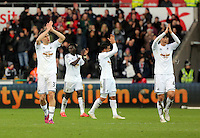 SWANSEA, WALES - FEBRUARY 21: Swansea players Federico Fernandez (L) and Ki Sung Yueng thank supporters at the end of the Barclays Premier League match between Swansea City and Manchester United at Liberty Stadium on February 21, 2015 in Swansea, Wales.