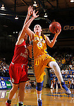 BROOKINGS, SD - FEBRUARY 21:  Ellie Thompson #45 from South Dakota State takes the ball to the basket past Kate Liveringhouse #34 from the University of South Dakota in the first half of their game Saturday evening at Frost Arena in Brookings. (Photo by Dave Eggen/Inertia)