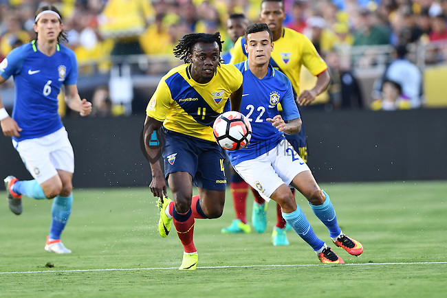 Ecuador Ecuador midfielder Michael Arroyo (11) and Brazil midfielder Philippe Coutinho (22) battle for the ball during Copa America Centenario match, in Pasadena, CA. Saturday, Jun 04, 2016. Brazil and Ecuador are scoreless at the halftime. (TFV Media via AP) *Mandatory Credit*