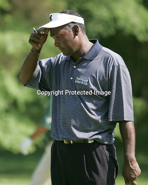Vijay Singh ponders a tough rolling green on the 12th hole at the Wachovia Championship, round one, Thursday, May 4, 2006 in Charlotte, North Carolina at the Quail Hollow Country Club.