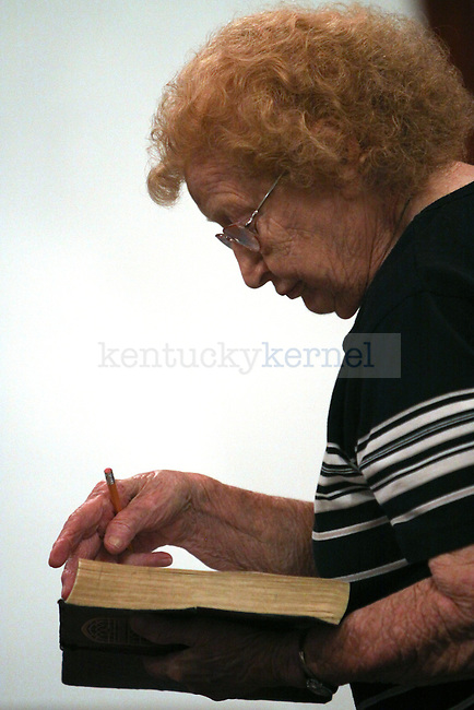 Edna Thomas, 89, reads her bible during a Wednesday night service at the Beattyville First Church of God in Lee County, KY.  Photo by Nikolas Kolenich