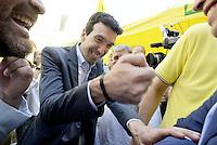 Roma, 8 Luglio 2015<br /> Piazza Montecitorio.<br /> Il ministro dell'agricoltura Maurizio Martina<br /> Una signora fa il formaggio con caglio vero.<br /> Made in Italy, no al formaggio senza latte, manifestazione di allevatori consumatori e casari, per impedire il via libera in Italia al formaggio e allo yogurt senza latte che danneggia ed inganna i consumatori, mette a rischio un patrimonio gastronomico custodito da generazioni, con effetti sul piano economico, occupazionale ed ambientale.