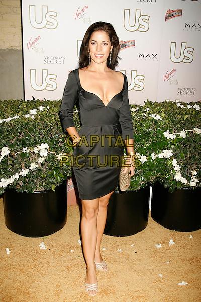 ANA ORTIZ .US Weekly Presents Us' Hot Hollywood 2007 held at Sugar,  Hollywood, California, USA..April 26th, 2007.full length black dress hand on pocket low cut neckline .CAP/ADM/RE.©Russ Elliot/AdMedia/Capital Pictures