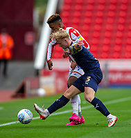 4th July 2020; Bet365 Stadium, Stoke, Staffordshire, England; English Championship Football, Stoke City versus Barnsley; Ben Williams of Barnsley tackles Tyrese Campbell of Stoke City