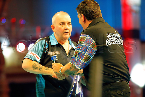 23.07.2016. Empress Ballroom, Blackpool, England. BetVictor World Matchplay Darts. Phil Taylor shakes hands with Gary Anderson