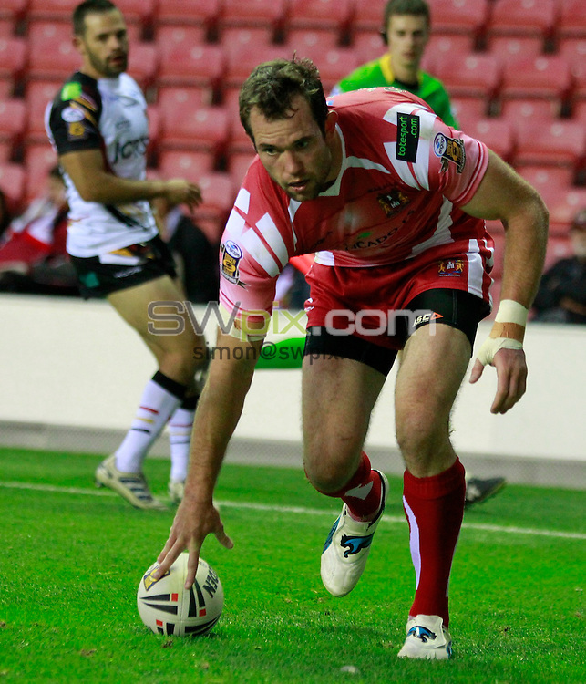 PICTURE BY CHRIS MANGNALL /SWPIX.COM...Rugby League - Super League - Wigan Warriors v Bradford Bulls - DW Stadium, Wigan, England - 19/08/11...Wigan's 4th try scored by Pat Richards.