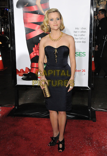 "REESE WITHERSPOON (wearing a Nina Ricci dress).World Premiere of ""Four Christmases"" held at The Kodak Theatre in Hollywood, California, USA..November 20th, 2008                                                                     .4 full length strapless gold necklace black navy blue heels shoes clutch bag .CAP/DVS.©Debbie VanStory/Capital Pictures."