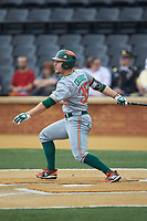 Chad Crosbie (35) of the Miami Hurricanes follows through on his swing against the Wake Forest Demon Deacons at David F. Couch Ballpark on May 11, 2019 in  Winston-Salem, North Carolina. The Hurricanes defeated the Demon Deacons 8-4. (Brian Westerholt/Four Seam Images)