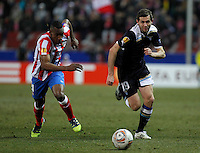 Atletico de Madrid's Luis Perea (l) and Lazio's Senad Lulic during Europa League match.February 23,2012. (ALTERPHOTOS/Acero) .Atletico Madrid Lazio Europa League.Italy Only
