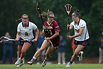 CHAPEL HILL, NC - MAY 12: Elon's Shannon Horan (31) is defended by Virginia's Kasey Behr (2) and Maggie Preas (right). The Elon University Phoenix played the University of Virginia Cavaliers on May 12, 2017, at Fetzer Field in Chapel Hill, NC in an NCAA Women's Lacrosse Tournament First Round match. Virginia won the game 11-9.