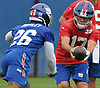 Kyle Lauletta #17, quarterback, right, and running back Saquon Barkley #26 practice during the second day of New York Giants Rookie Minicamp held at Quest Diagnostics Training Center in East Rutherford, NJ on Saturday, May 12, 2018.
