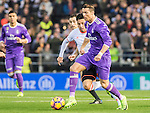 Cristiano Ronaldo (c) of Real Madrid competes for the ball with Enzo Nicolas Perez (l) of Valencia CF during their La Liga match between Valencia CF and Real Madrid at the Estadio de Mestalla on 22 February 2017 in Valencia, Spain. Photo by Maria Jose Segovia Carmona / Power Sport Images
