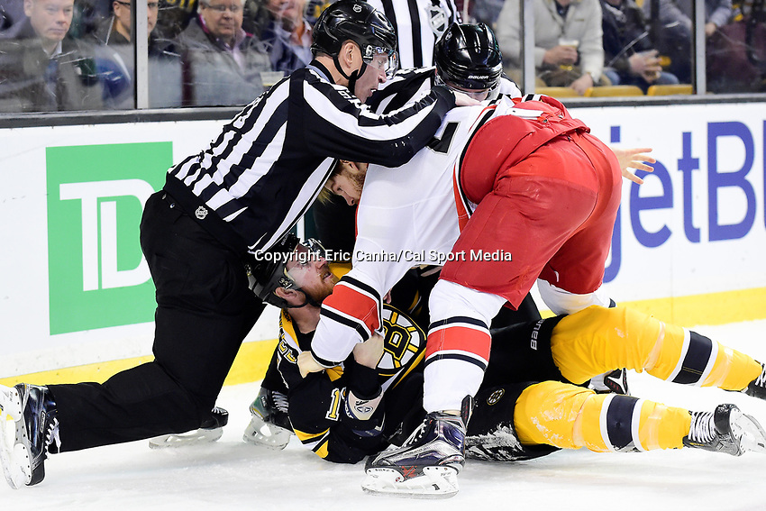Tuesday, April 5, 2016: Boston Bruins right wing Jimmy Hayes (11) ends up on the ice while fighting Carolina Hurricanes center Brad Malone (24) during the National Hockey League game between the Carolina Hurricanes and the Boston Bruins held at TD Garden, in Boston, Massachusetts. Eric Canha/CSM