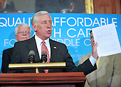 Washington, DC - July 14, 2009 -- United States House Majority Leader Steny H. Hoyer (Democrat of Maryland), Democratic members of the U.S. House of Representatives holds up a statement by U.S. President Barack Obama on the Health Care Reform Legislation, as he makes remarks during a press conference where he and fellow Democratic members of the U.S. House of Representatives unveiled the America's Affordable Health Choice Act of 2009 in the Rayburn Room of the U.S. Capitol on Tuesday, July 14, 2009..Credit: Ron Sachs / CNP