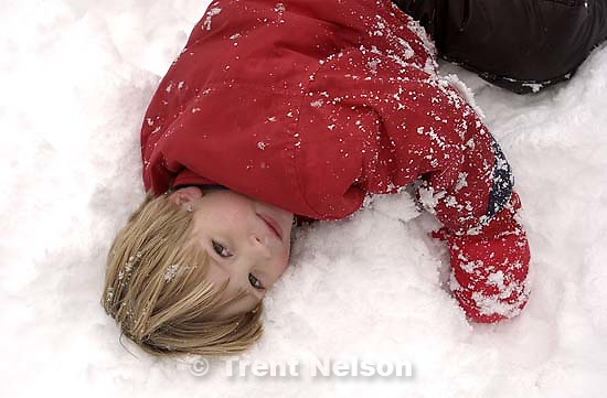 Nathaniel Nelson playing in the snow. 11/25/2001, 4:33:34 PM<br />