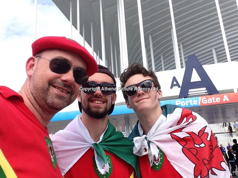 Pictured: Family handout picture of Ifan Owens (C) with dad Gareth (L) and brother Tomi at the Euros in Bordeaux in 2016<br /> Re: Five men have been sentenced after admitting their part in an attack which left 20 year old university student Ifan Owens in a coma.<br /> Ifan Owens, 20, from Cardiff, was attacked and found unconscious on High Street, Aberystwyth, on 14 January 2018.<br /> Billy Valentine, 19, pleaded guilty to causing grievous bodily harm with intent at a previous hearing and was sentenced to seven and a half years at a young offenders' institution.<br /> David Robert Lloyd, 25, of no fixed address, was jailed for three years and eight months; Lee Andersen, 20, of Newcastle Emlyn, received a 25-month jail term; and both Andrew Raymond John Scott, 23, of Llangwyryfon, and Michael Jones, 24, of Llanfair Clydogau, received 30-month sentences.