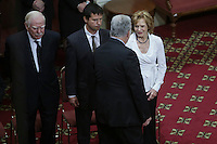 Quebec Premier Philippe Couillard gives his condolences to Lisette Lapointe, wife of former Quebec premier Jacques Parizeau, as her husband lies in state at the National Assembly in Quebec City on Sunday June 7, 2015.