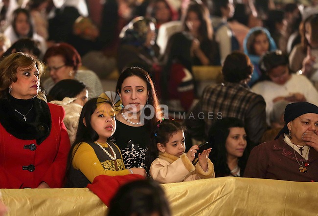 Egyptian Christians take part in the Coptic Orthodox Christmas Eve mass in St. Mark church in Cairo on January 6, 2016. Photo by Stringer