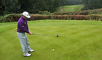 Graeme McDowell prepares to tee off during a Pro-Am round ahead of the 2015 British Masters at the Marquess Course, Woburn, in Bedfordshire, England on 7/10/15.<br /> Picture: Richard Martin-Roberts   Golffile
