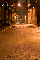 Low Angle View of Dark Alley at Night, Cortland Alley, Chinatown, New York City....THIS IMAGE IS AVAILABLE EXCLUSIVELY FROM GETTY IMAGES.....Please search for image # 200552895-001 on www.gettyimages.com....