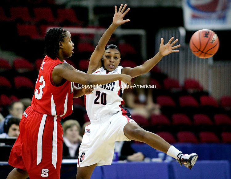 FRESNO, CA. 24 March 2007-032407SV08--#20 Renee Montgomery of UConn triesto block a passby #23 Shayla Fields of NC State during the sweet sixteen round of the NCAA tournament at the Save Mart Center in Fresno, CA. Saturday.<br /> Steven Valenti Republican-American