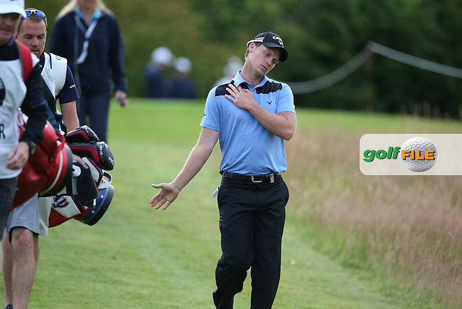 Danny Willett (ENG) checks his neck and shoulder as he stays in touch with Rafa Cabrera-Bello (ESP) with a flawless 68 during Round Two of the BMW International Open 2014 from Golf Club Gut Lärchenhof, Pulheim, Köln, Germany. Picture:  David Lloyd / www.golffile.ie